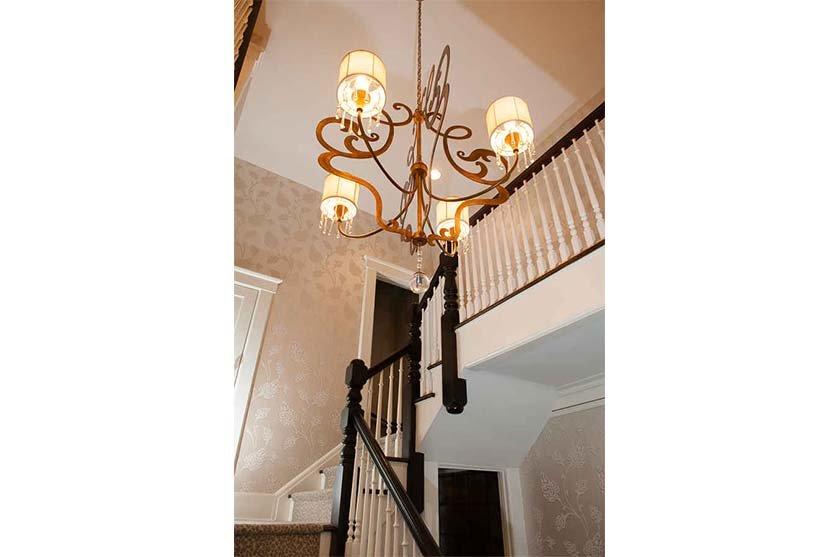 Chandelier Over Spiral Staircase Interior Design